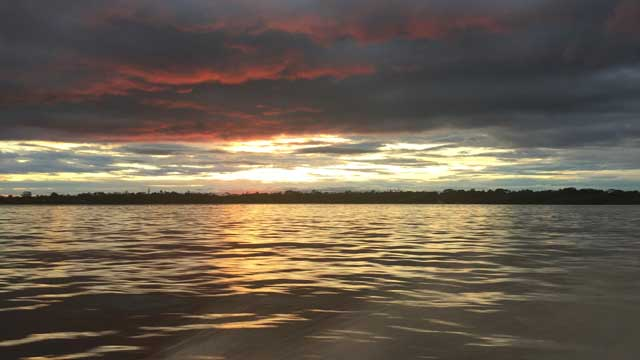 Sunset over Amazon river